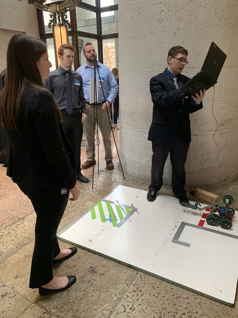 Hunter presenting VEX Robotics to Senator Theresa Gavarone's aide